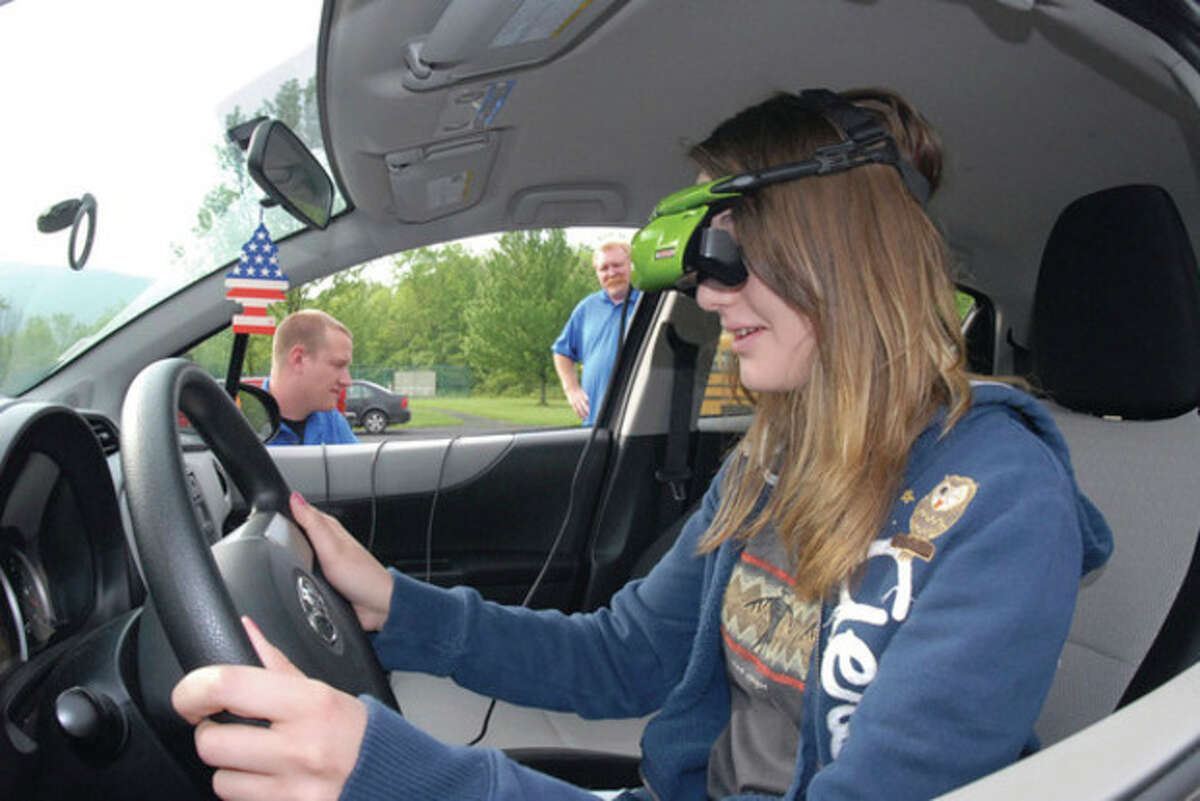 AP photo / The Times-News, Steven Bittner Hyndman Charter School senior Marissa Miller takes part in a PEER Awareness Reality Check Tour distracted driving program May 9 in Hyndman, Pa.