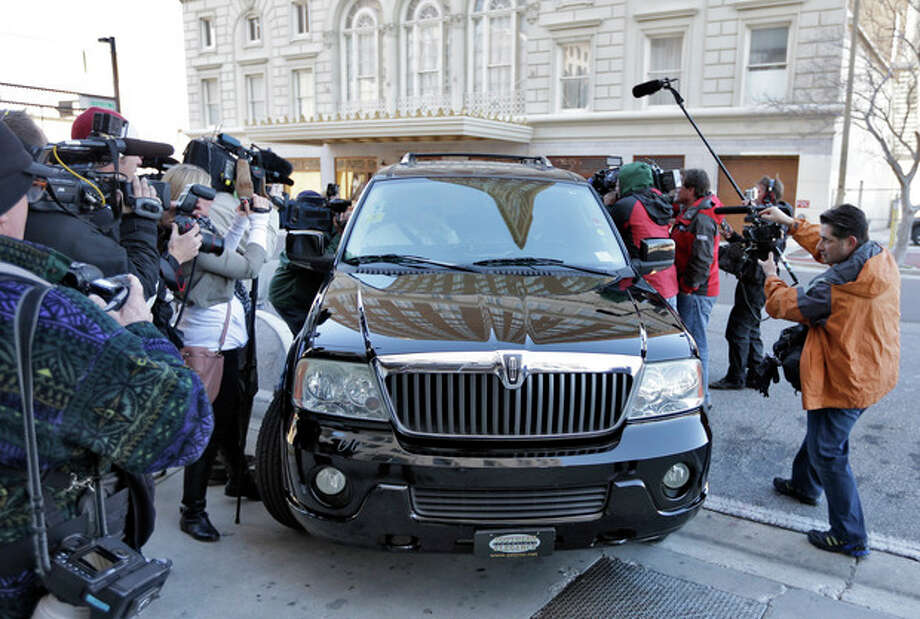 Casey Anthony's vehicle is surrounded by the media as she arrives at the United States Courthouse for a bankruptcy hearing Monday, March 4, 2013, in Tampa, Fla. Anthony has not been seen in public since being acquitted in 2011 of murdering her two-year-old daughter Caylee. (AP Photo/Chris O'Meara) / AP