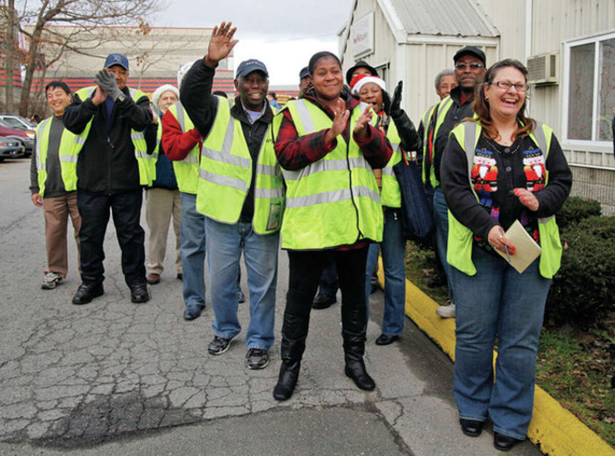 """Hour Photo / Danielle Robinson Co-workers help celebrate Robert """"Rev"""" Story's retirement Friday afternoon."""