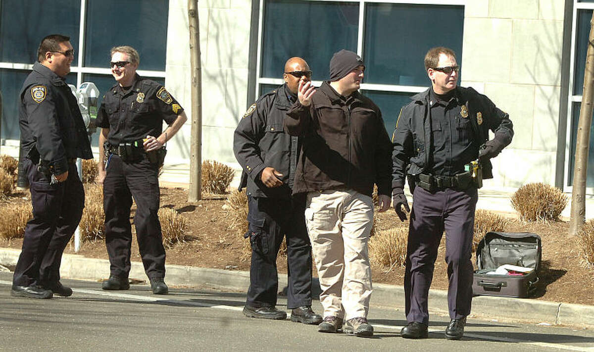 Hour Photo/ Alex von Kleydorff. Norwalk Police, Fire and MTA Police investigate a suspicious package at the Condo complex at 35-53 Ann St in SONO Tuesday morning
