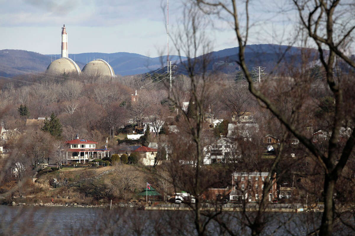 This Wednesday, Dec. 16, 2009 picture shows reactor containment domes of the Indian Point nuclear power plant in Buchanan, N.Y. above the homes just north of the town of Verplanck, N.Y. as seen from the Stony Point Historic Site. In changes which went into effect on December 2011, the U.S. government is allowing communities within 50 miles of nuclear power plants to practice less often for major accidents and is recommending that far fewer people who live nearby be evacuated immediately. Under new emergency planning rules, federal regulators also are ending a requirement that emergency personnel always practice for a release of radiation. (AP Photo/Julie Jacobson)