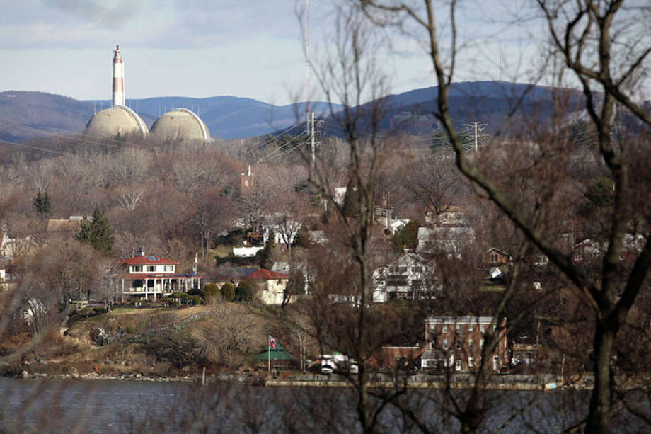 This Wednesday, Dec. 16, 2009 picture shows reactor containment domes of the Indian Point nuclear power plant in Buchanan, N.Y. above the homes just north of the town of Verplanck, N.Y. as seen from the Stony Point Historic Site. In changes which went into effect on December 2011, the U.S. government is allowing communities within 50 miles of nuclear power plants to practice less often for major accidents and is recommending that far fewer people who live nearby be evacuated immediately. Under new emergency planning rules, federal regulators also are ending a requirement that emergency personnel always practice for a release of radiation. (AP Photo/Julie Jacobson) / AP