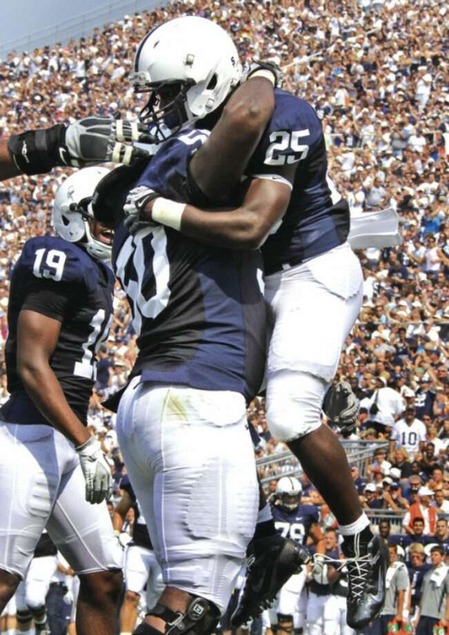 AP photo Penn State running back Silas Redd leaps into the arms of DeOn'tae Pannell after scoring against Indiana State last Saturday. A Norwalk resident, Redd has emerged as Penn State's top running back.