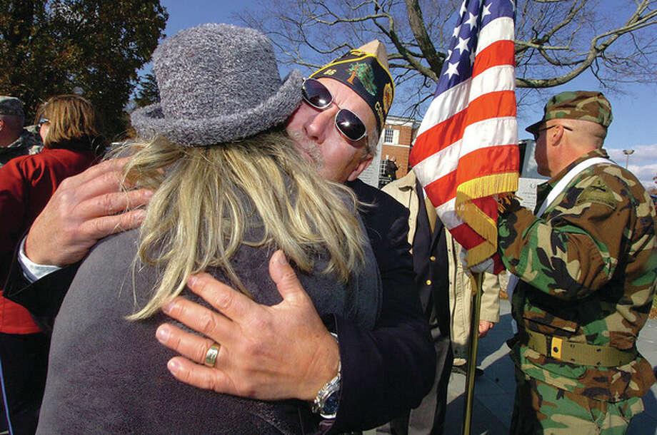 Hour Photo/ Alex von Kleydorff. Don Hazzard, Commander, Post 86 American Legion , Wilton, hugs his wife Charmaine after an emotional Veterans Day program in Wilton. / 2011 The Hour Newspapers