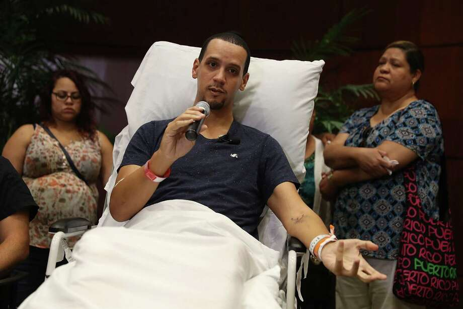Angel Santiago speaks to the media from the Florida Hospital about being shot in the Pulse gay nightclub terror attack on June 14, 2016, in Orlando, Fla. Omar Mateen killed 49 people and injured 53 others in what is the deadliest mass shooting in the country's history. Photo: Joe Raedle /Getty Images / 2016 Getty Images