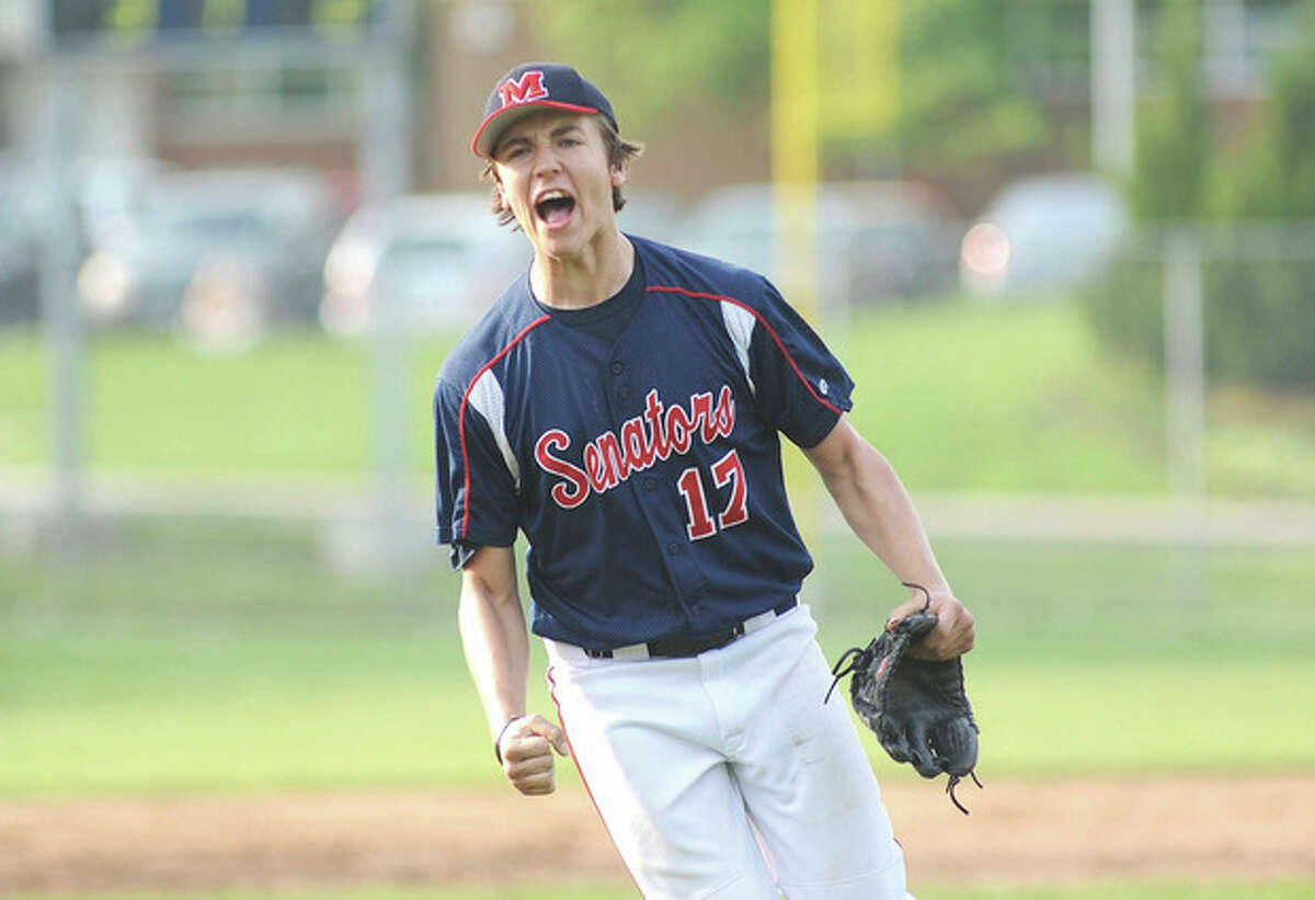 Hour photo/John Nash Brien McMahon freshman Paul Salata lets out a yell as he leaves the mound after shutting the door on Staples Wednesday afernoon. Salata made his varsity debut in the seventh inning and got the save in the Senators' 3-2 victory.