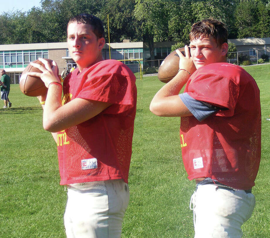 Two players, one job -- Trinity looks for a quarterback