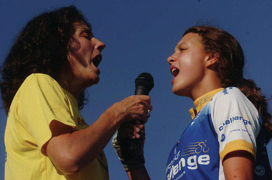 Amy Kuzmicki and her daughter Jessie sing the national anthem at The 2011 Connecticut Challenge Bike Ride at Fairfield County Hunt Club in Westport Saturday. / (C)2011, The Hour Newspapers, all rights reserved
