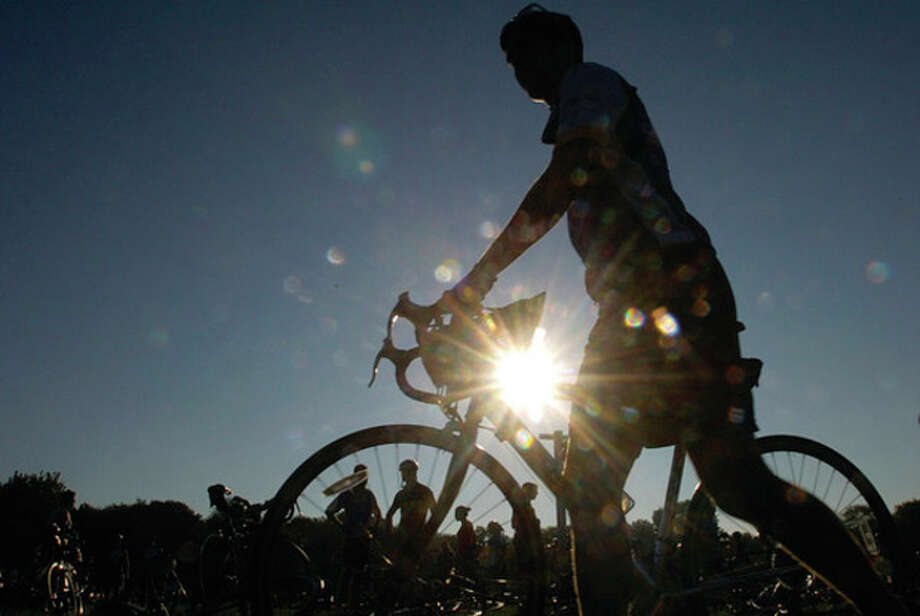 Riders prepare for The 2011 Connecticut Challenge Bike Ride at Fairfield County Hunt Club in Westport Saturday. / (C)2011, The Hour Newspapers, all rights reserved