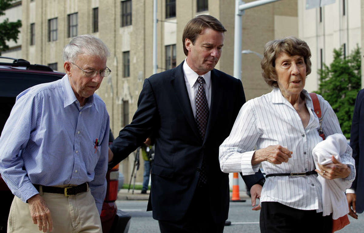 John Edwards, center, and his mother Bobbie Edwards, right, and his father Wallace Edwards, left, arrive at a federal courthouse for John Edwards' trial on charges of campaign corruption in Greensboro, N.C., Wednesday, May 16, 2012. Edwards has pleaded not guilty to six counts related to campaign finance violations over nearly $1 million from two wealthy donors used to help hide the Democrat's pregnant mistress as he sought the White House in 2008. (AP Photo/Chuck Burton)