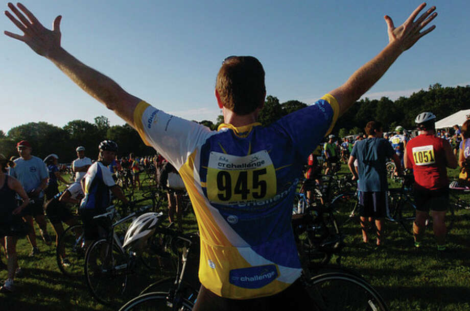 Mike Smaldone stretches to prepare for The 2011 Connecticut Challenge Bike Ride at Fairfield County Hunt Club in Westport Saturday. / (C)2011, The Hour Newspapers, all rights reserved