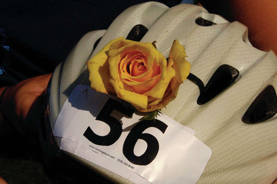 A rose was worn to honor a cancer victim at The 2011 Connecticut Challenge Bike Ride at Fairfield County Hunt Club in Westport Saturday. / (C)2011, The Hour Newspapers, all rights reserved