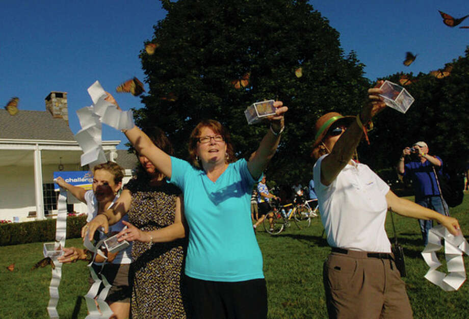 Kim Bielicki of Bridgeport Hospital releases Monarch butterflies with Sharyn Taymor, Julia Pemberton and Philana Solomon during the opening ceremonies at The 2011 Connecticut Challenge Bike Ride at Fairfield County Hunt Club in Westport Saturday. / (C)2011, The Hour Newspapers, all rights reserved