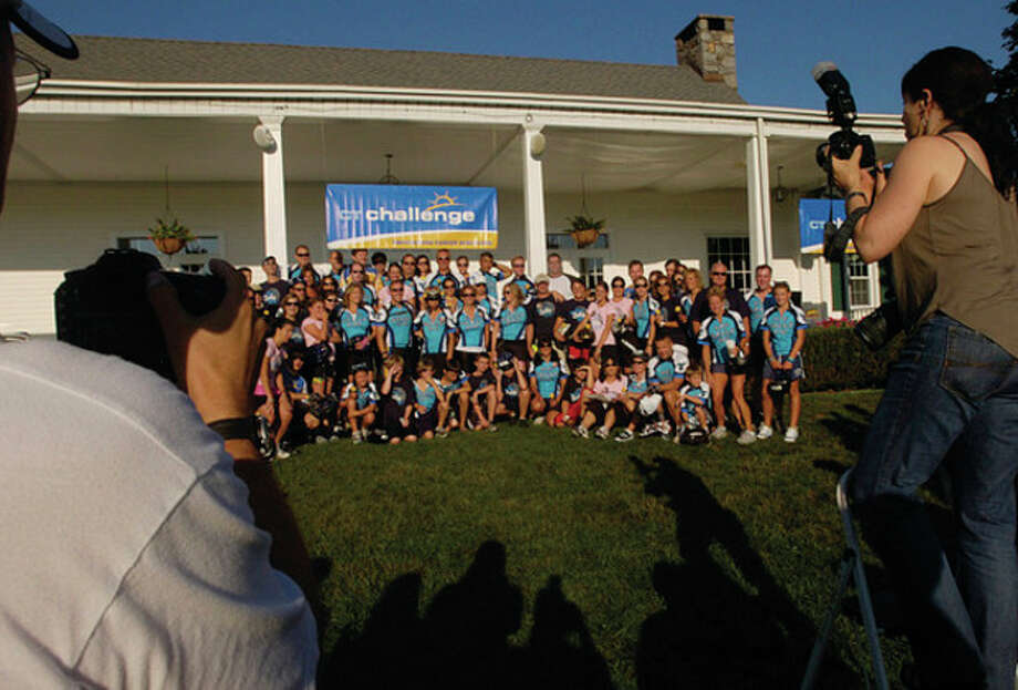 Groups pose for photographs at The 2011 Connecticut Challenge Bike Ride at Fairfield County Hunt Club in Westport Saturday. / (C)2011, The Hour Newspapers, all rights reserved