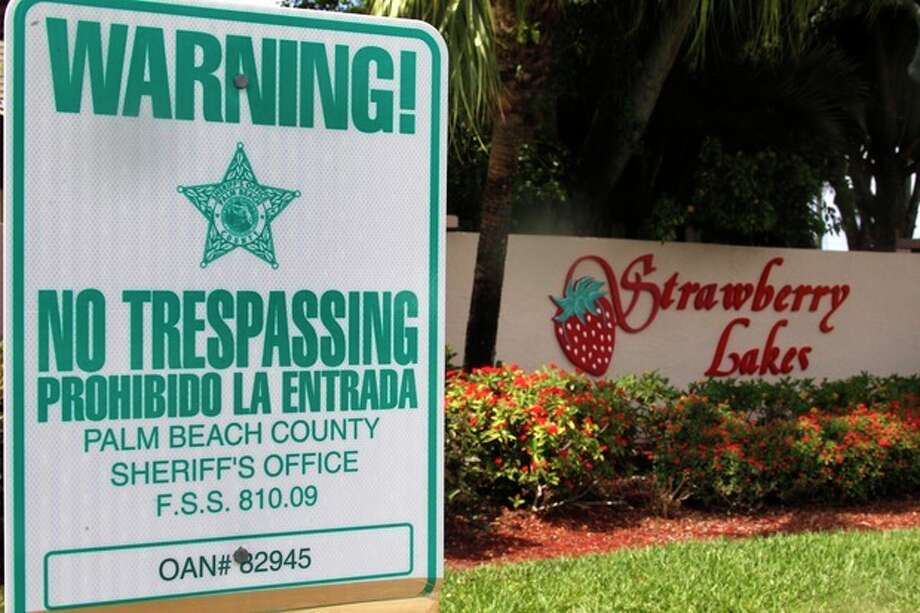 """FILE - In this Friday, March 16, 2012 file photo, a """"No Trespassing"""" sign is shown in front a neighborhood of 262 homes called Strawberry Lakes, in Lake Worth, Fla. National foreclosure trends took a positive turn in April, as the number of homes seized by banks declined and fewer properties entered into the foreclosure process RealtyTrac Inc. said Thursday May 17, 2012. But state-level data point to potentially more home repossessions ahead in Florida and many of the 25 other states where courts are required to sign off on foreclosures. (AP Photo/Wilfredo Lee) / AP2012"""