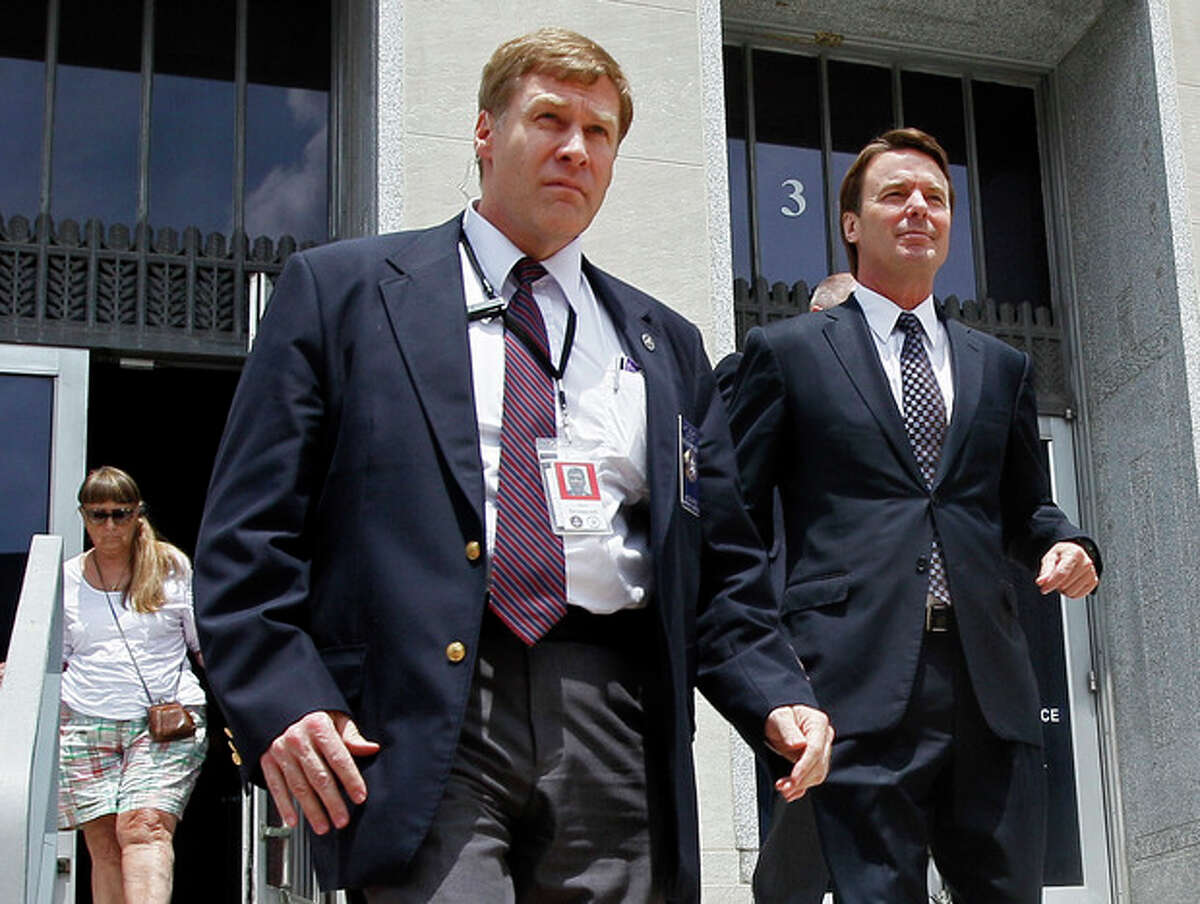 Former presidential candidate and Sen. John Edwards, right, leaves a federal courthouse in Greensboro, N.C., Wednesday, May 16, 2012. Edwards has pleaded not guilty to six counts related to campaign finance violations over nearly $1 million from two wealthy donors used to help hide the Democrat's pregnant mistress as he sought the White House in 2008. (AP Photo/Gerry Broome)