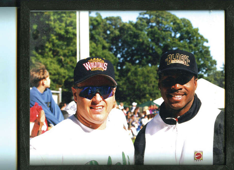 Contributed photoJeb Backus of Westport, left, stands with home run king Barry Bonds on the day in 1994 when Backus beat Bonds in a home run contest at Cubeta Stadium.