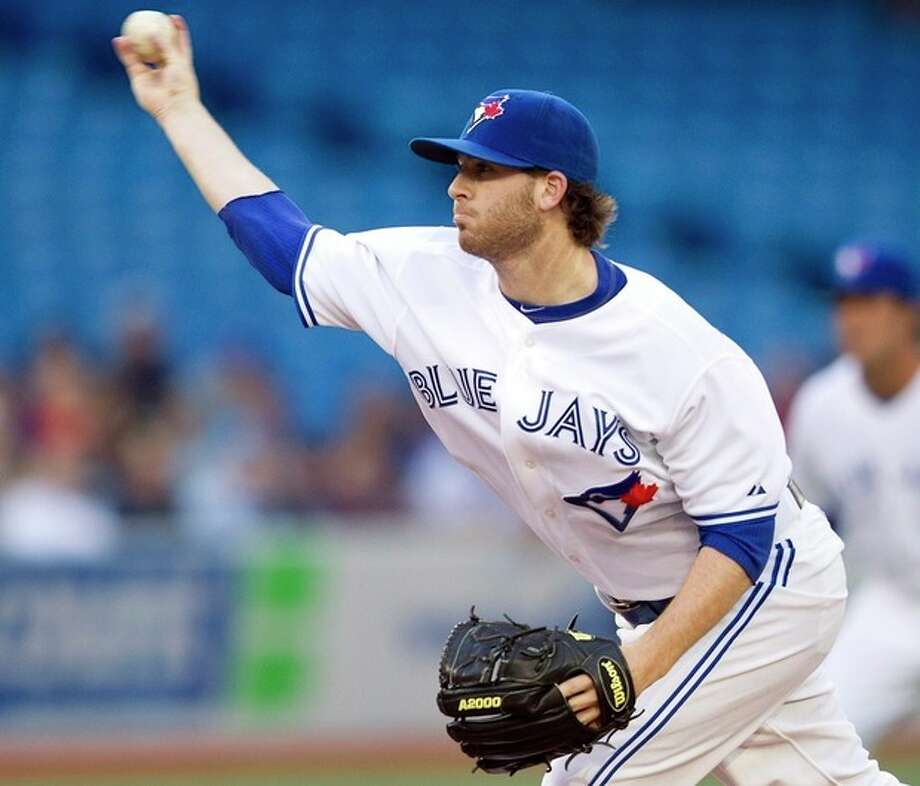 Toronto Blue Jays starting pitcher Drew Hutchison throws to the New York Yankees during first-inning AL baseball game action in Toronto, Thursday May 17, 2012. (AP Photo/The Canadian Press, Frank Gunn) / The Canadian Press