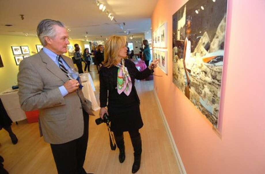 Photo/Alex von Kleydorff. AmeriCares CEO Curt Welling and ''Hope in Haiti'' Curator Helen Klisser During talk about the images from Haiti at the opening reception Thursday at The Westport Arts Center.