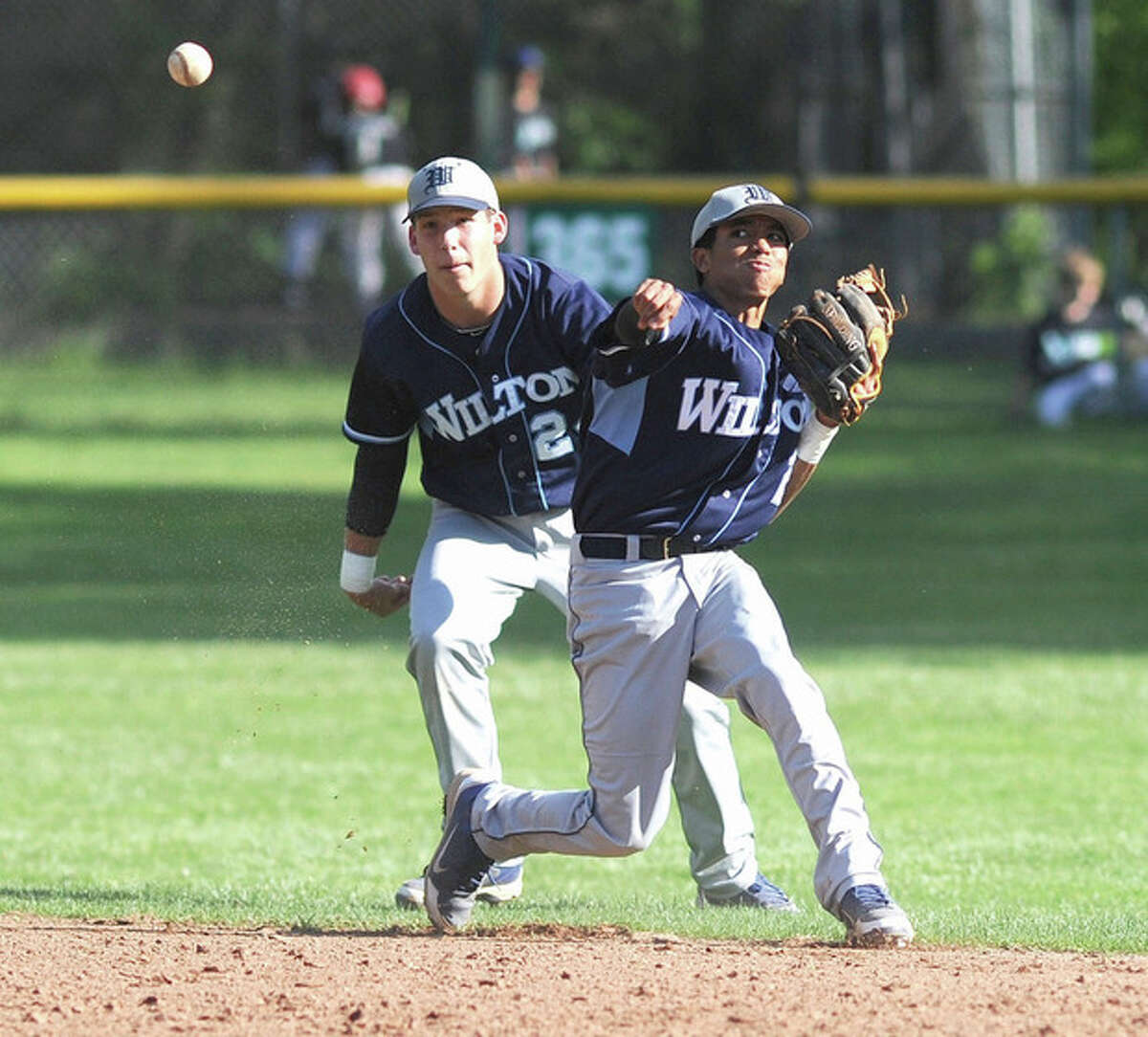 Hour photo/John Nash Wilton second baseman Jordan Prince, right, comes up firing to first on a ground ball hit up the middle as shortstop Brett Phillips looks on. Prince made the play for an out.