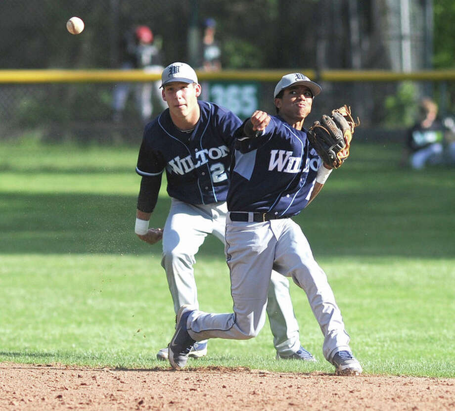 Hour photo/John NashWilton second baseman Jordan Prince, right, comes up firing to first on a ground ball hit up the middle as shortstop Brett Phillips looks on. Prince made the play for an out.