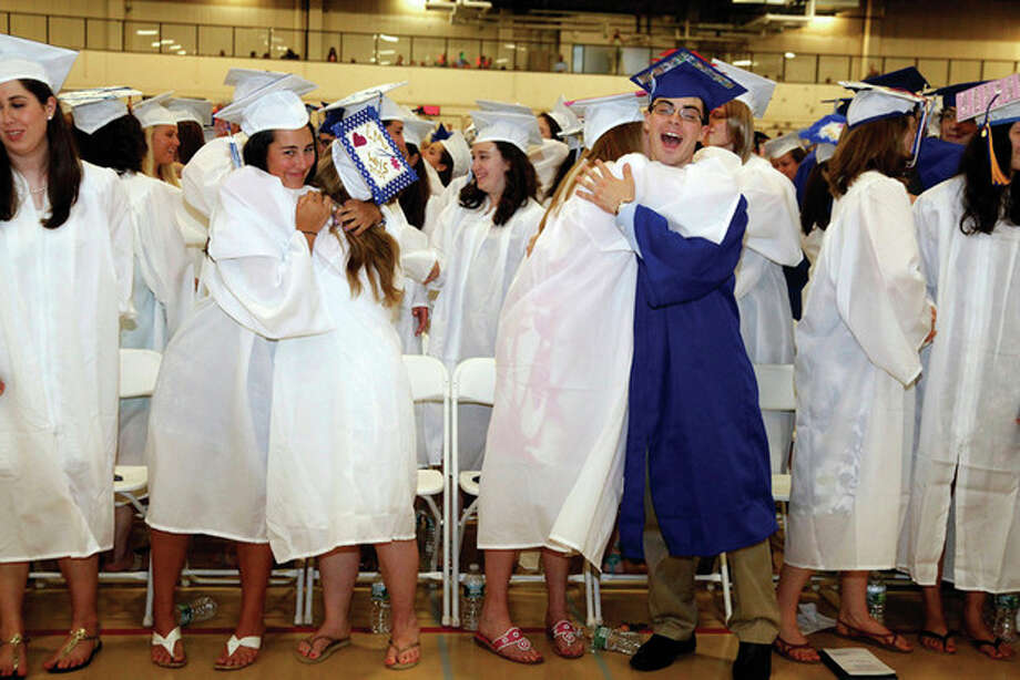 Wilton High graduates hug during the schoolÕs 53rd graduation ceremony on Saturday, June 25. Photo by Danielle Robinson.