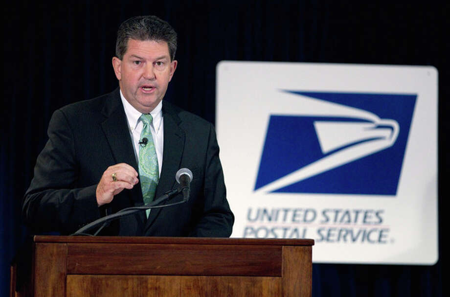 FILE - In this Sept. 15, 2011, file photo Postmaster General Patrick Donahoe speaks at a news conference on changes to the Postal Service that could potentially save as much as $3 billion in Washington. The estimated $3 billion in reductions, to be announced in broader detail on Monday, Dec. 5, 2011, are part of a wide-ranging effort by the Postal Service to quickly trim costs and avert bankruptcy. While providing short-term relief, the changes could ultimately prove counterproductive, pushing more of America's business onto the Internet.( AP Photo/Evan Vucci) / AP
