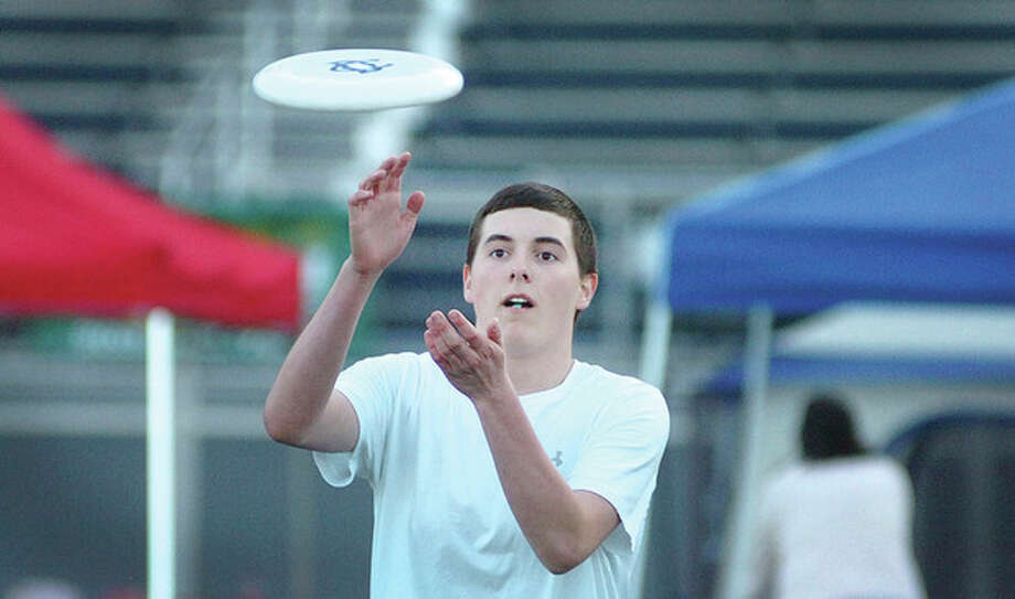 Hour Photo/ Alex von Kleydorff. John DeMattia grabs a Frisbee during Wiltons Relay for Life. / 2012 The Hour Newspapers