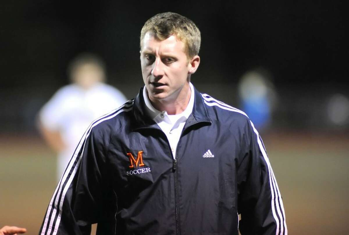 Hour photo/John Nash - Ken Dustin, who has coached Brien McMahon's boys soccer team for two years, was named the school's new varsity basketball coach on Friday.