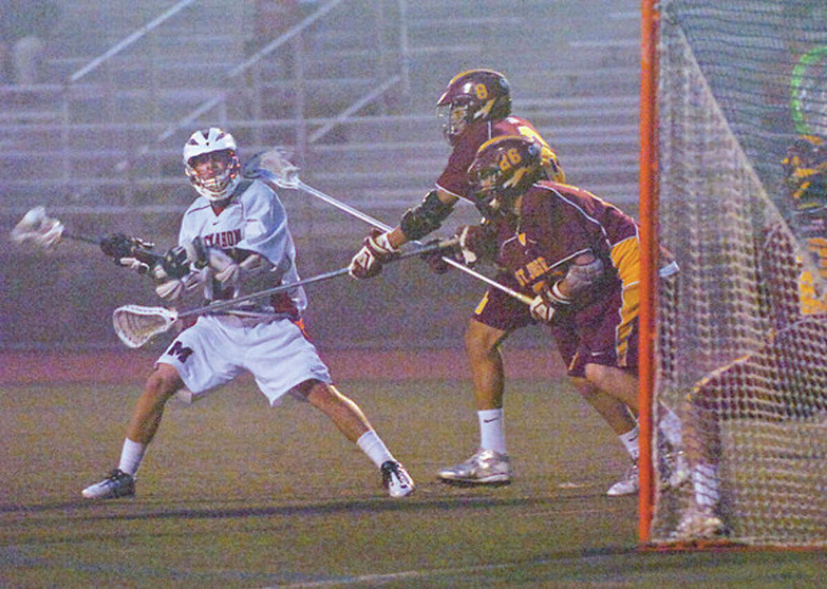 #2 for BMHS, Greg Watson, takes a shot on goal during their game against St. Joes Tuesday night. Hour photo / Erik Trautmann