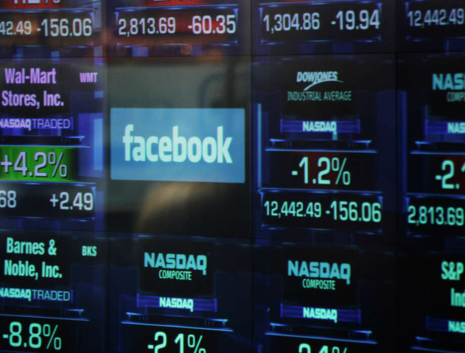 The Facebook logo appears on a display inside the NASDAQ Marketsite in Times Square Thursday, May 17, 2012, in New York. Facebook priced its IPO at $38 per share on Thursday, at the high end of its expected range. If extra shares reserved to cover additional demand are sold as part of the transaction, Facebook Inc. and its early investors stand to reap as much as $18.4 billion from the IPO. (AP Photo/Frank Franklin II) / AP