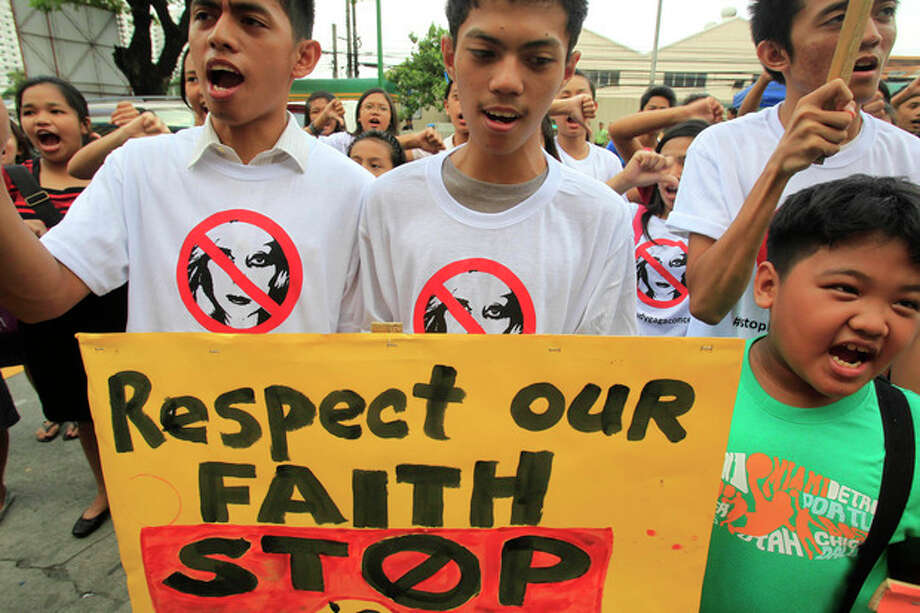 "Filipino Christian youths chant ""Stop the Lady Gaga concerts"" during a rally, calling for the cancellation of the singer's May 21-22 concerts, outside the Pasay City Hall in Pasay, south of Manila, Philippines, Friday, May 18, 2012. The youths said they are offended by Lady Gaga's music and videos, in particular her song ""Judas"" which they say mocks Jesus Christ. Lady Gaga's concert was marked also by protest from evangelical groups in South Korea and the singer scrapped an Indonesia concert following protests from conservative Muslims. (AP Photo/Bullit Marquez) / AP"