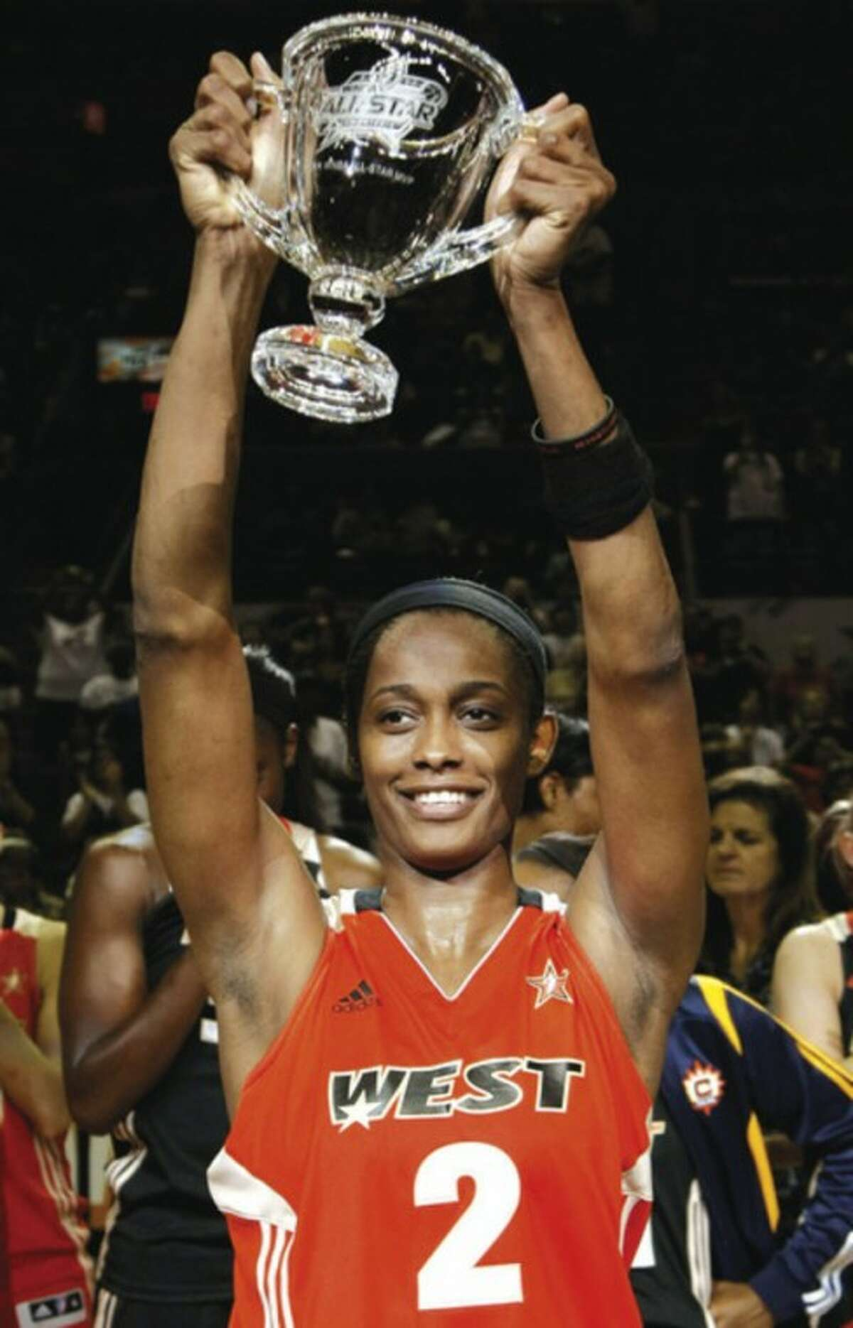 AP photo Swin Cash holds up her MVP trophy after the WNBA All-Star basketball game Saturday. Cash?•s West team lost, 118-113.