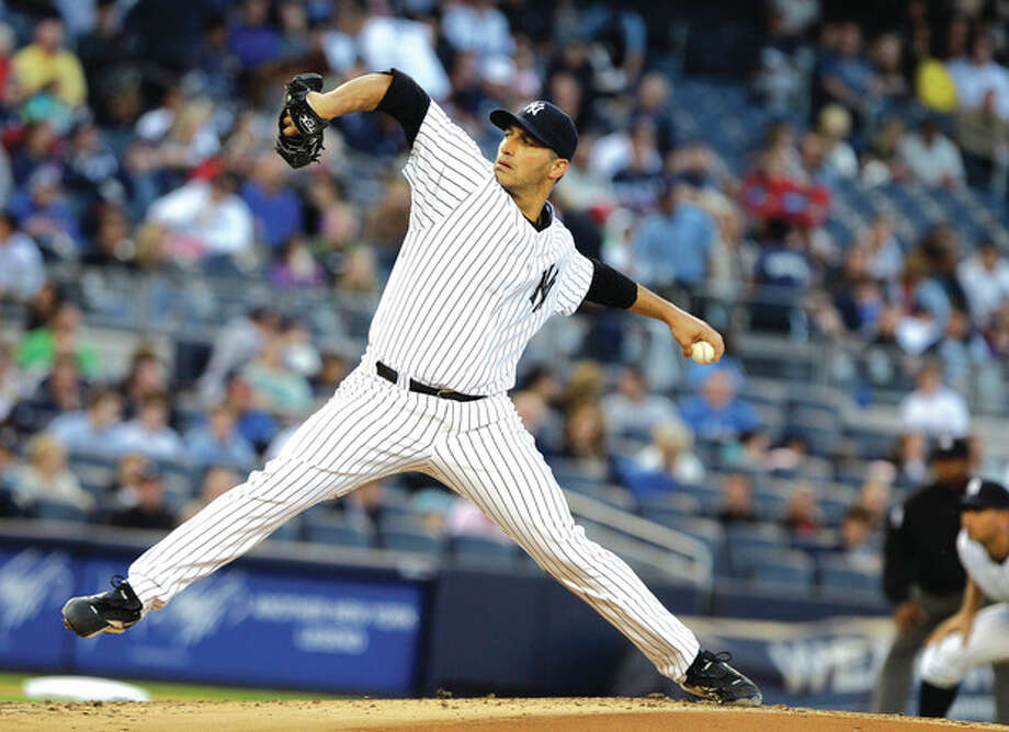 AP photoNew York Yankees starter Andy Pettitte delivers a pitch during the second inning of Friday night's game against the Cincinnati Reds at Yankee Stadium. The lefty pitched eight shutout innings and fanned nine in New York's 4-0 victory. / AP