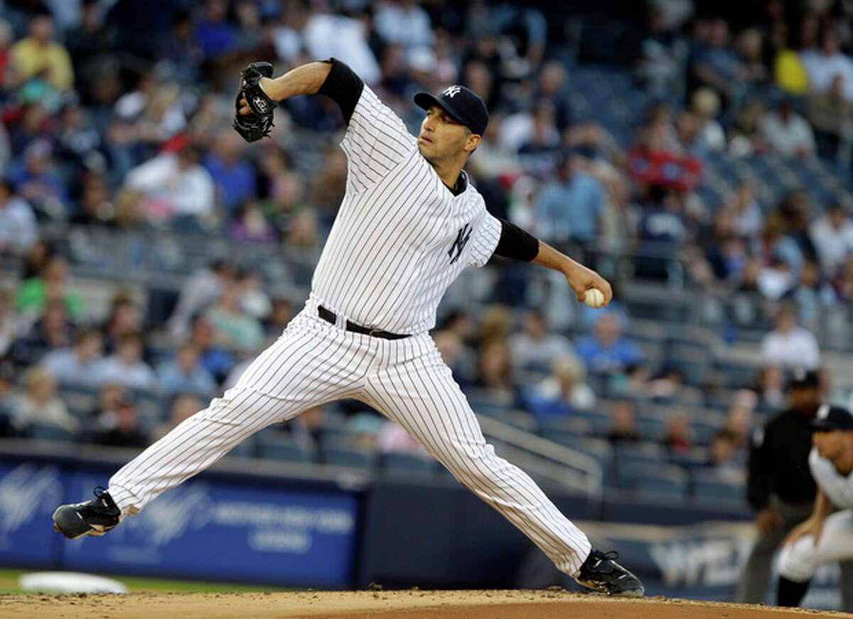 New York Yankees' Andy Pettitte delivers a pitch during the second inning of an interleague baseball game against the Cincinnati Reds, Friday, May 18, 2012, in New York. (AP Photo/Frank Franklin II)