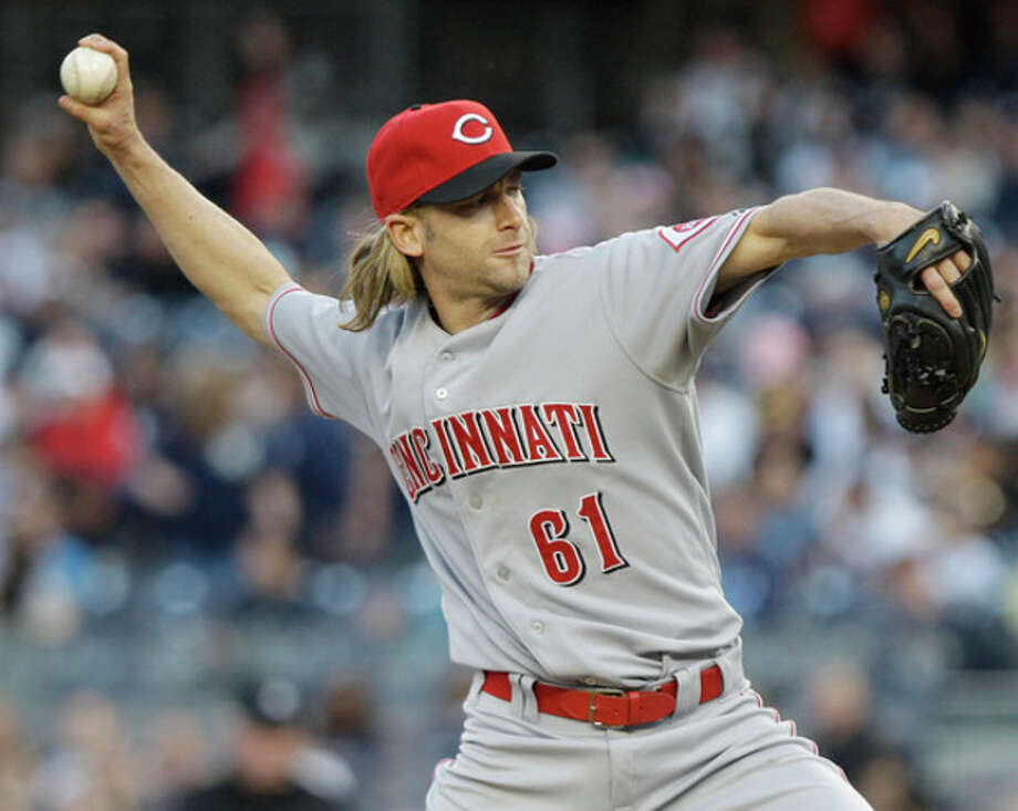 Cincinnati Reds' Bronson Arroyo (61) delivers a pitch during the first inning of an interleague baseball game against the New York Yankees, Friday, May 18, 2012, in New York. (AP Photo/Frank Franklin II) / AP