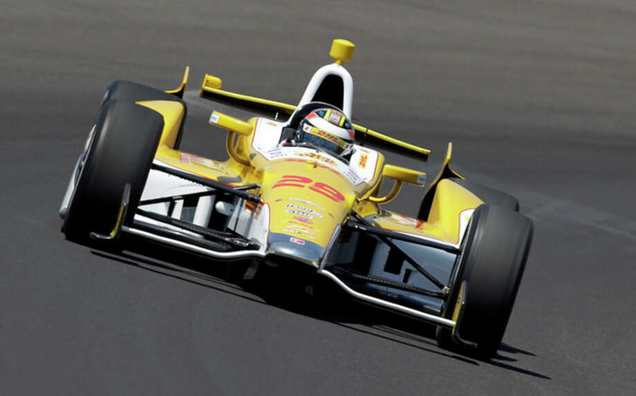IndyCar driver Ryan Hunter-Reay drives through the first turn during practice for the Indianapolis 500 auto race at the Indianapolis Motor Speedway in Indianapolis, Friday, May 18, 2012. (AP Photo/Darron Cummings) / AP