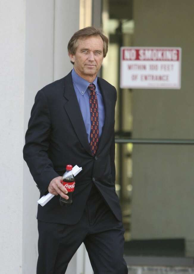 Robert F. Kennedy Jr. leaves the Westchester County Courthouse in White Plains, N.Y., on Friday, May 18, 2012, after he and members of the Mary Richardson Kennedy family met in court to decide who would get possession of his late wife's body. Mary Richardson Kennedy committed suicide by hanging herself on Wednesday, May 16, 2012. She was 52. ( AP Photo/The Journal News, Mark Vergari) NYC OUT, NO SALES, ONLINE OUT, TV OUT, NEWSDAY INTERNET OUT