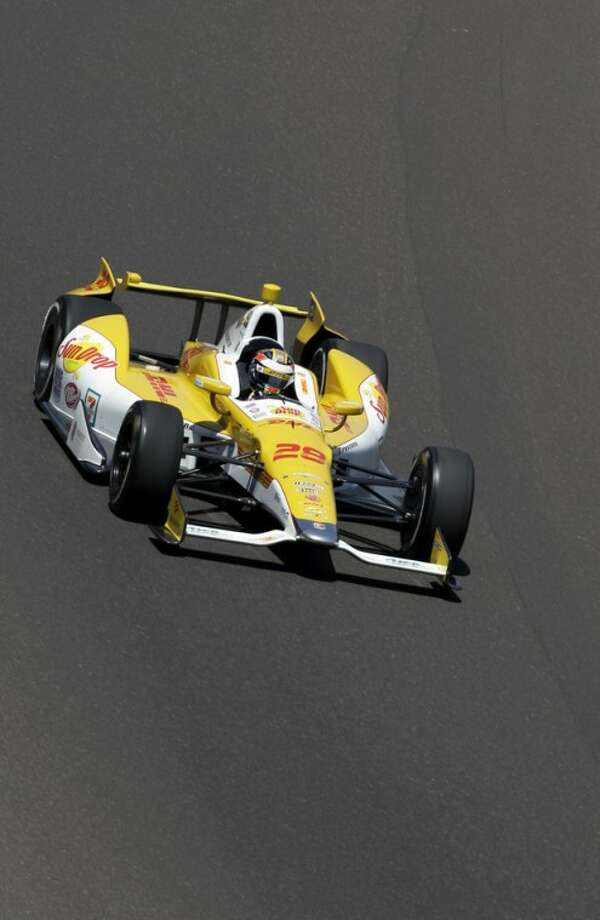 IndyCar driver Ryan Hunter-Reay drives through the first turn during practice for the Indianapolis 500 auto race at the Indianapolis Motor Speedway in Indianapolis, Friday, May 18, 2012. (AP Photo/Darron Cummings)