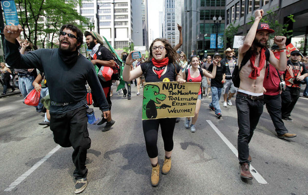 Protesters march through the streets of downtown Chicago at a NATO summit demonstration in downtown Chicago, Friday, May 18 2012. (AP Photo/ Nam Y. Huh)