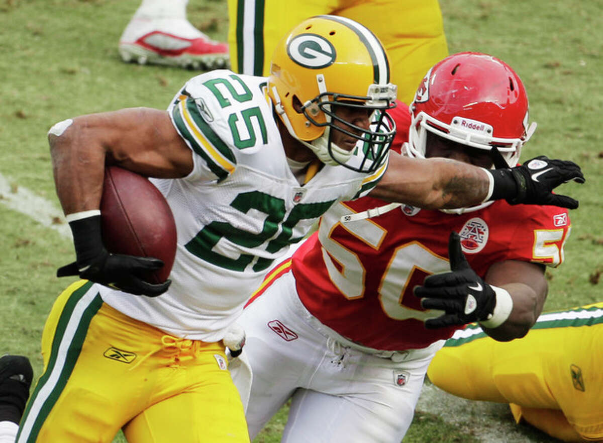 Green Bay Packers running back Ryan Grant (25) gets past Kansas City Chiefs outside linebacker Justin Houston (50) during the second half of an NFL football game at Arrowhead Stadium in Kansas City, Mo., Sunday, Dec. 18, 2011. (AP Photo/Charlie Riedel)