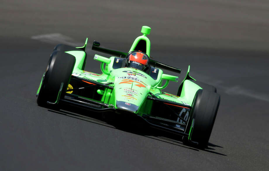 IndyCar driver James Hinchcliffe, of Canada, drives through the first turn during practice for the Indianapolis 500 auto race at the Indianapolis Motor Speedway in Indianapolis, Friday, May 18, 2012. (AP Photo/Darron Cummings) / AP