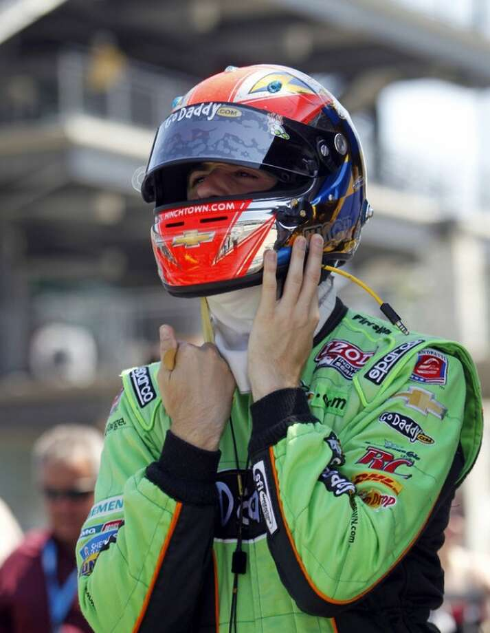 IndyCar driver James Hinchcliffe, of Canada, prepares to drive during practice for the Indianapolis 500 auto race at the Indianapolis Motor Speedway in Indianapolis, Friday, May 18, 2012. (AP Photo/Tom Strattman)