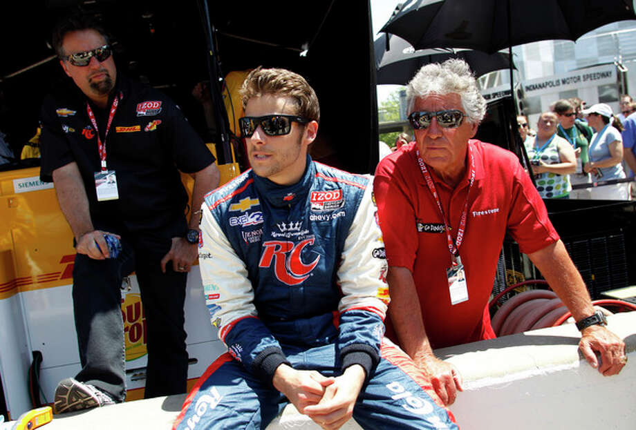 IndyCar driver Marco Andretti, center, is joined by his father and car owner Michael Andretti, left, and his grandfather Mario Andretti, the 1969 Indy 500 champion, during practice for the Indianapolis 500 auto race at the Indianapolis Motor Speedway in Indianapolis, Friday, May 18, 2012. (AP Photo/Tom Strattman) / FR29600 AP