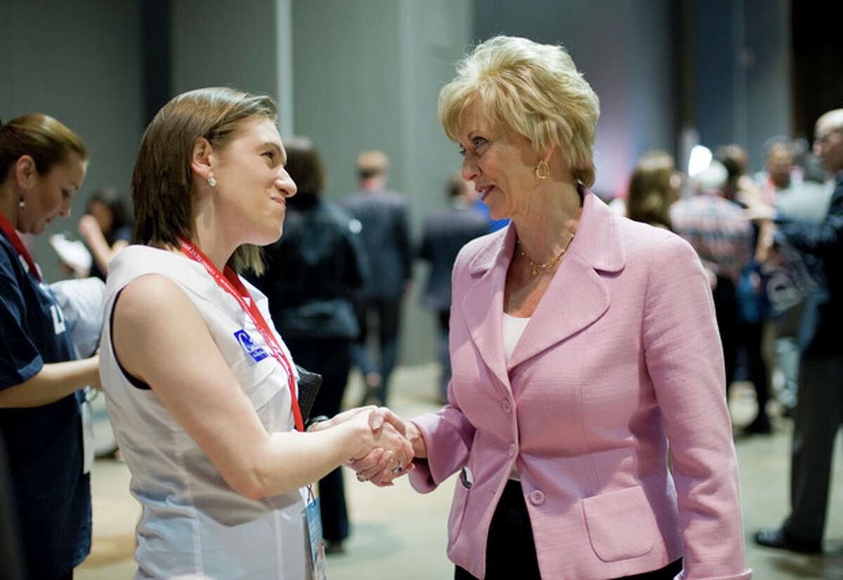 Republican candidate for U.S. Senate Linda McMahon, right, shakes hands with supporter Julia Sorensen at the Republican state convention in Hartford, Conn., Friday, May 18, 2012. (AP Photo/Jessica Hill)