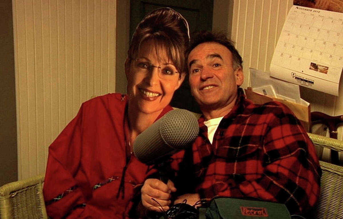 In this film image released by the Freestyle Releasing, director Nick Broomfield poses with a cardboard cut-out of former Republican Vice Presidential candidate Sarah Palin in a scene from the documentary ?'Sarah Palin: You Betcha!