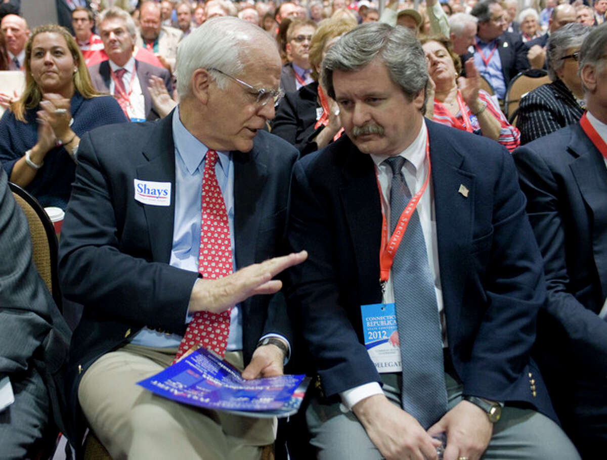 Republican candidate for U.S. Senate Chris Shays, left, talks with Greenwich delegate John Whetmore, right, at the Republican state convention in Hartford, Conn., Friday, May 18, 2012. (AP Photo/Jessica Hill)