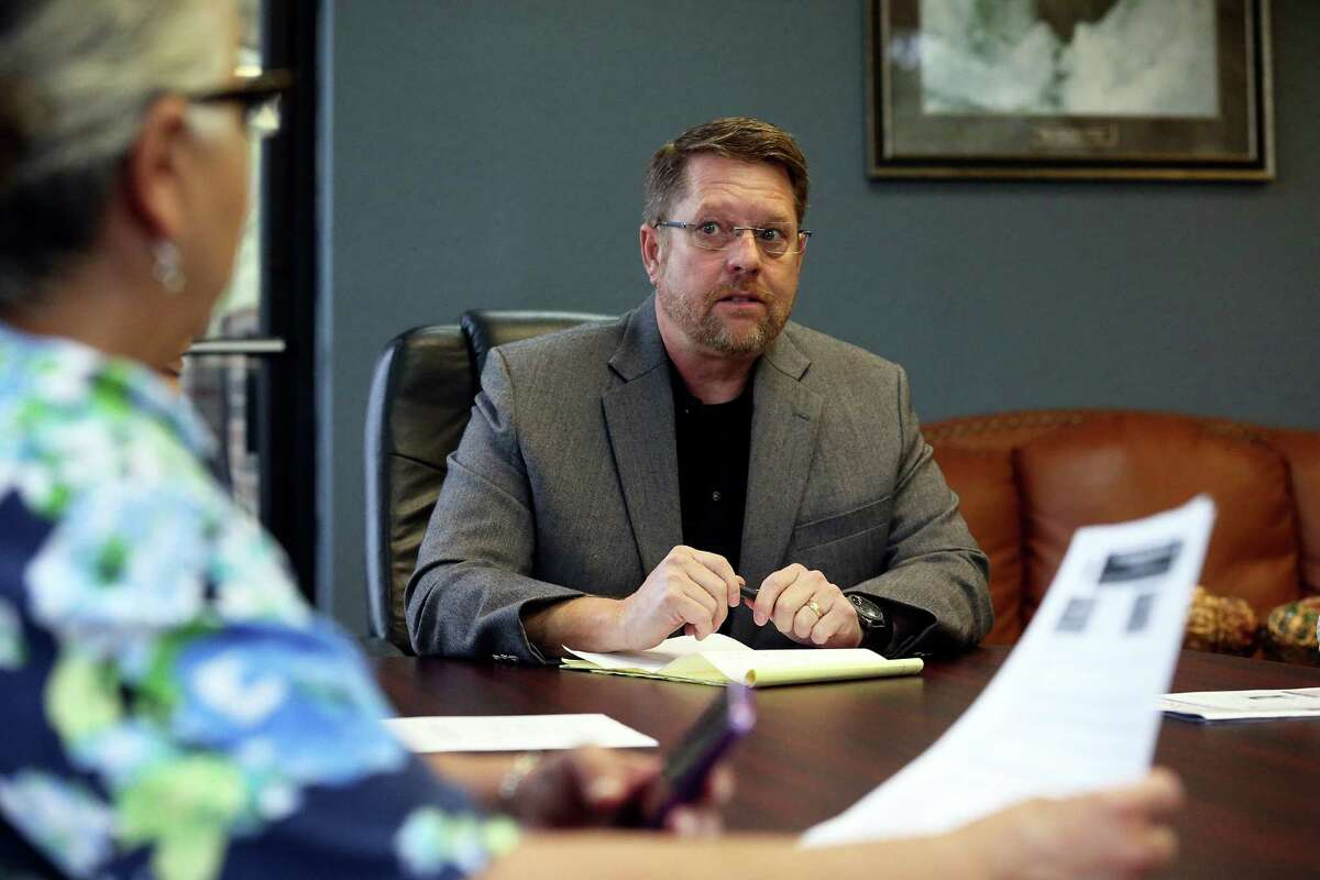 Mike Helle, president of the San Antonio Police Officers Association meets with staff in his office on April 6, 2016.