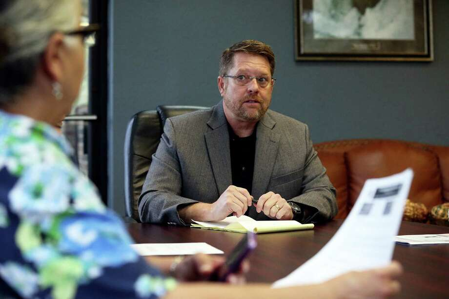 Mike Helle, president of the San Antonio Police Officers Association meets with staff in his office on  April 6, 2016. Photo: TOM REEL, STAFF / SAN ANTONIO EXPRESS-NEWS / 2016 SAN ANTONIO EXPRESS-NEWS