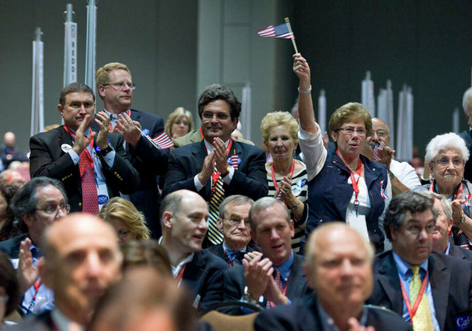 Delegates cheer at the Republican state convention in Hartford, Conn., Friday, May 18, 2012. (AP Photo/Jessica Hill) / AP2012